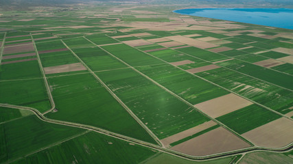 large fields and agricultural activities in the countryside