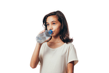 Girl Drinking Water. Portrait of cute little girl drinking water over white background