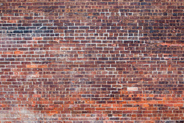 Empty old retro red brick wall background on sunny summer day in Brooklyn, New York, USA