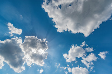 Clouds on the blue sky at day time.