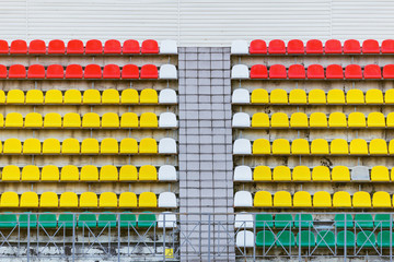 Colorful seats on the tribune of the old stadium.
