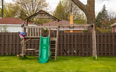 Swing set in backyard during spring season