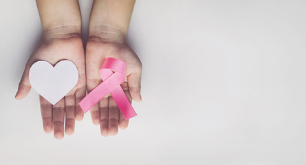 Child holding pink ribbon. breast cancer awareness