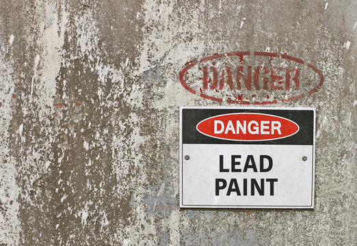 red, black and white Danger, Lead Paint warning sign