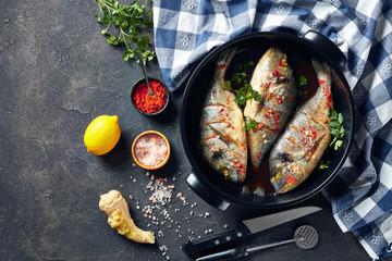 Raw dorado fishies marinated with spices, flatlay