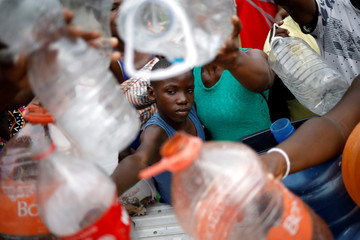 African and Haitian migrants ask for water to nuns from Misioneras de Cristo Resucitado in Tapachula