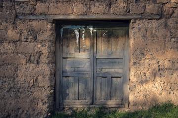 wood door in adobe house