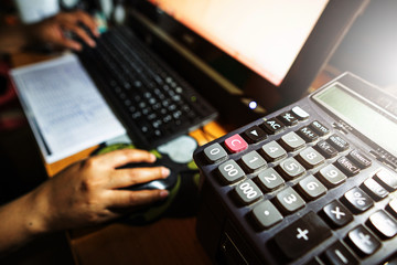 Business accounting concept, Business woman using calculator with computer laptop, budget and loan paper in office