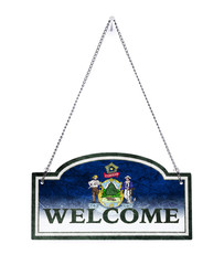 Maine welcomes you! Old metal sign isolated