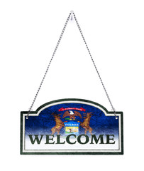 Michigan welcomes you! Old metal sign isolated