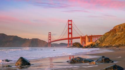 Wall Mural - Famous Golden Gate Bridge seen from Baker Beach in beautiful golden evening light
