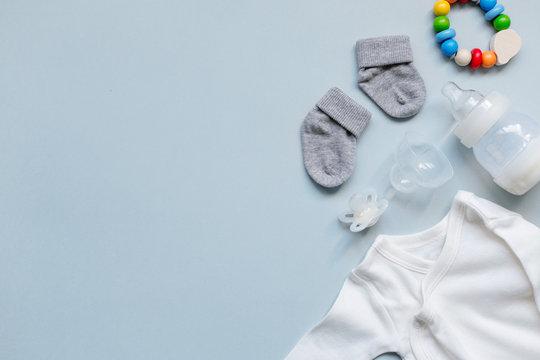 Baby goods on light blue background