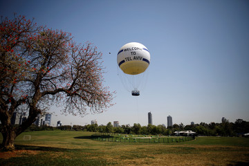 A hot air balloon is seen above the ground in Tel Aviv, Israel