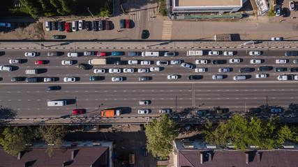 Top down aerial view of urban traffic jam rush hour highway.