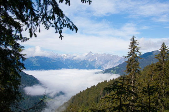 Mountain view with valley covered in clouds in Montafon Austria