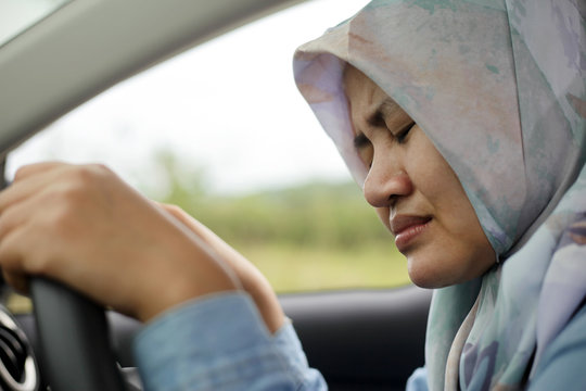 Sad Muslim Lady Driving Her Car and Crying