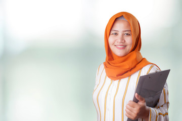 Muslim Woman Holds Clipboard