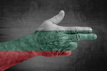 Bulgaria flag painted on male hand like a gun