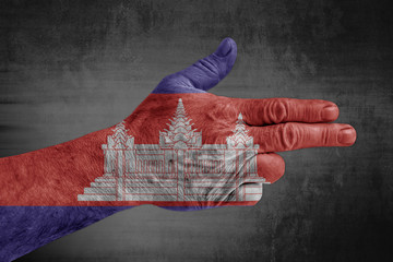 Cambodia flag painted on male hand like a gun