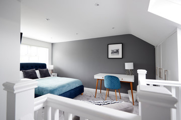 Interior of a house, loft conversion bedroom seen across stair banister