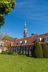 Old almshouses around a small, green courtyard (Sint Anthony Gasthuis) in the Dutch city of Groningen. Netherlands