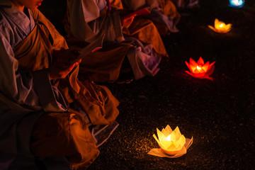 Monks praying at night on Vesak day for celebrating Buddha's birthday in Eastern culture