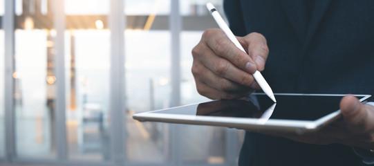 Businessman using digital tablet with stylus