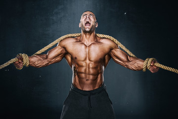 Strong Muscular Men Trapped in Ropes Trying to brake lose. Bodybuilder Trapped in Ropes