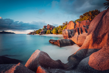 Unique shaped granite boulders and a dramatic sunset at Anse Source d'Argent beach, La Digue island, Seychelles. Long Exposure Fototapete