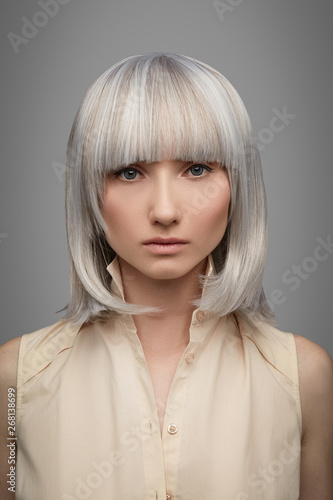 Cropped Front View Shot Of Girl With Silver Short Haircut