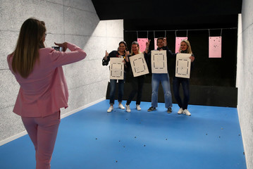 Simonotti of the Swiss Gun Center takes a picture of a group of women who took a class after a birthday celebration in Geneva
