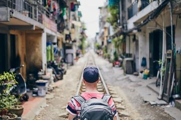 Traveler in Hanoi Train Street