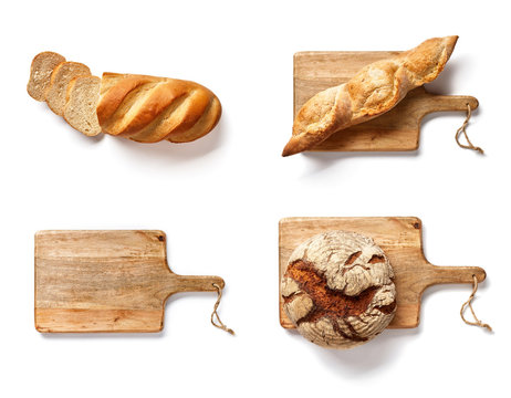 Bakery mockup. Set of baked breads on wooden cutting board isolated. Loaf and wooden board on white background. Top view.