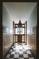 Moroccan interior, tile mosaic and arab lamp
