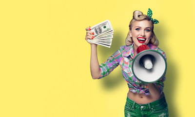 Photo of smiling woman with cash money and megaphone, dressed in pin up style, over yellow background
