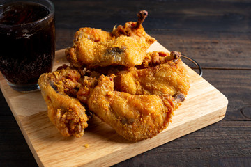fried chicken in a wooden table.