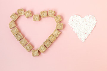 Brown sugar cubes and granulated white sugar in heart shapes