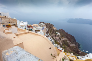 View of byzantine castle ruins and white houses of Oia village