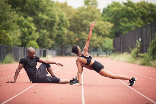 Couple athlete exercising on running track