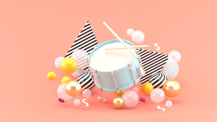 Blue snare among the colorful balls on the pink background.-3d rendering.