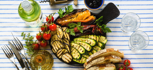 banner of grilled vegetables on the table with white wine, fresh bread and aromatic herbs. summer menu Wall mural