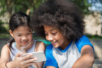 Two girls watching a video on phone together