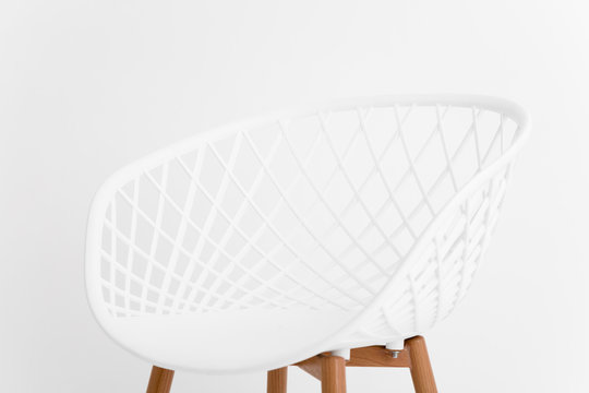 Minimalist chair isolated over clean seamless background