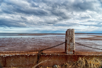 A muddy shore at low tide.