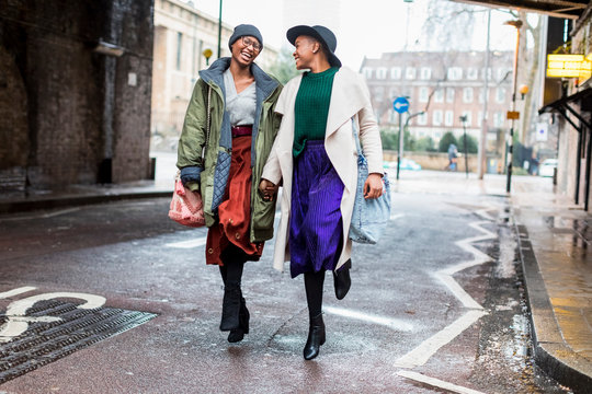 Stylish female friends meeting  in London