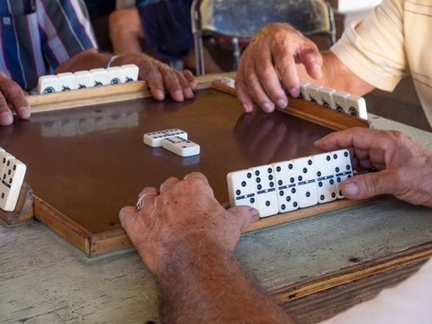 Hands of Elderly Domino Players