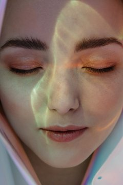 Surreal portrait of daydreaming girl with underwater lightning on her face