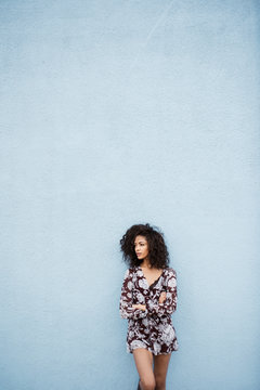 Young Woman Standing Against a Wall.