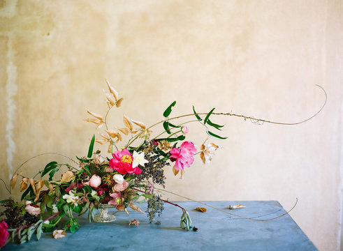Bright gold and pink floral centerpiece