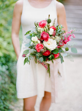 Bridesmaid holding beautiful spring bouquet